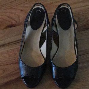 Cole Haan black leather peep toe wedges